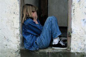 sad child outside magazine